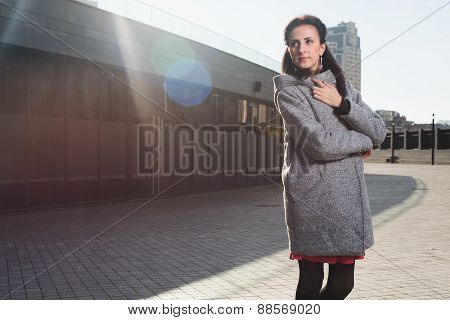 Beauty portrait of young adult woman in city. Urban scene.