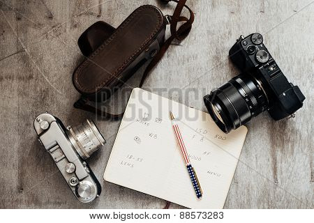Men's Accessories , Top View On A Wooden Background Retro Camera Notebook Pen