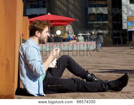 Happy Man Eating Food On Lunch Break Outdoors