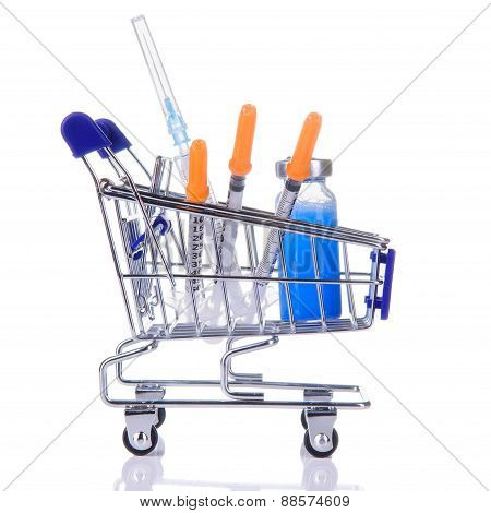different medications in the cart from supermarket. close-up isolated on white background