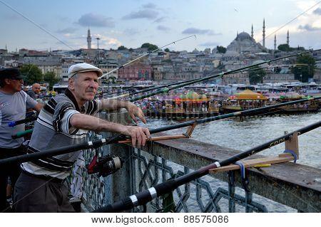 Man fishing on the Galata Bridge, Istanbul, Turkey