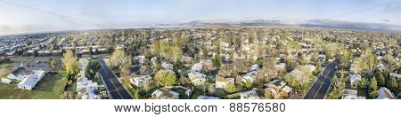FORT COLLINS, CO, USA - APRIL 20 2015: Aerial panorama of Fort Collins, a typical residential neighborhood along Front Range of Rocky Mountains in Colorado,  early spring with some snow