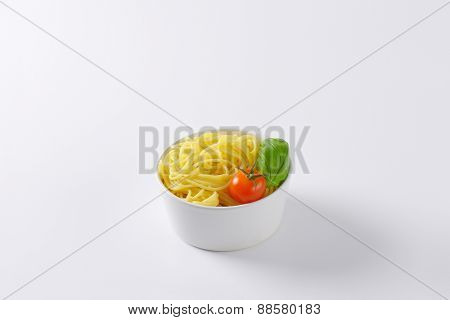 bowl of cooked spaghetti on white background
