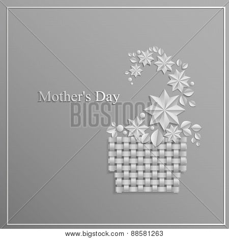 Card, paper flower arrangement in a basket on Mother's Day on a gray background