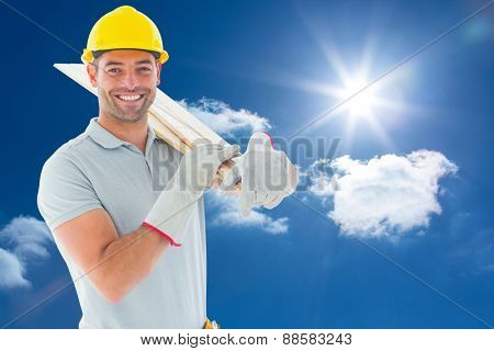 Happy carpenter against sky