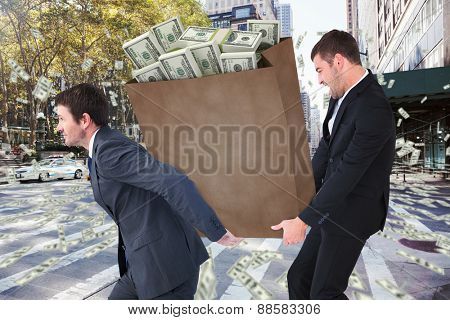 Businessmen carrying bag of dollars against new york street