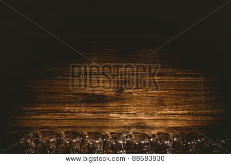 Row of light bulb on wooden table