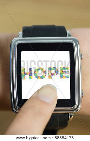 Businesswoman with smart watch on wrist against autism message of hope