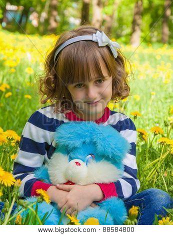 Child portrait with plush rabbit