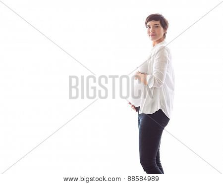 Pregnant woman holding her bump on white background