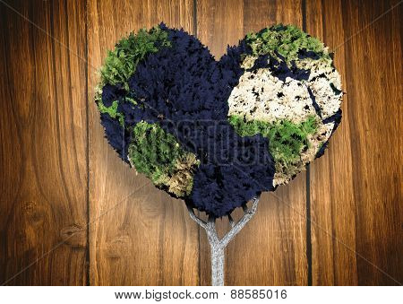 Heart shaped earth tree against wooden table