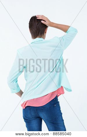Pretty brunette touching her hair on white background