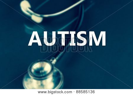 autism against black stethoscope in the dark