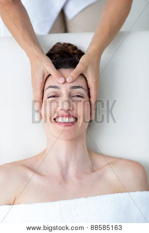 Physiotherapist doing head massage in medical office