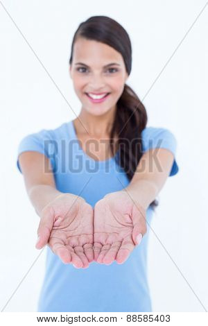 Happy woman presenting her hands on white background