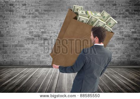Businessman smiling with hands out against grey room