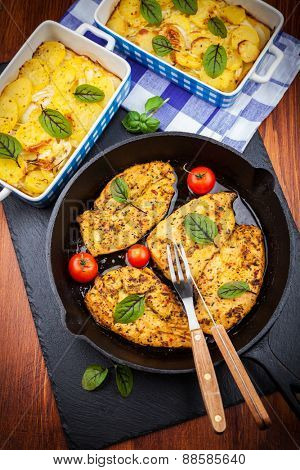 Marinated chicken breast with potato gratin