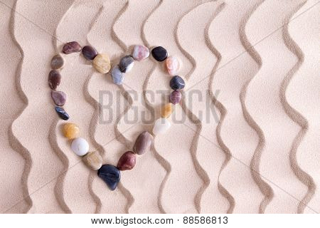 Decorative Pebble Heart On Golden Beach Sand