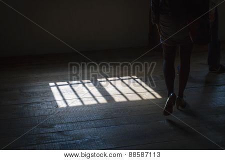 Woman Walking In Shadows