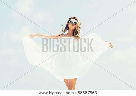 Sexy Woman Walking And Posing On  Blue Sky And Sea