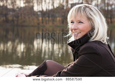 Portrait of a beautiful cheerful girl outdoors.