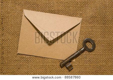 Vintage Key And Envelope On Old Cloth