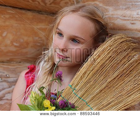 young girl with broom and flowers