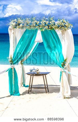 beach wedding venue, wedding setup, cabana, arch, gazebo decorated with flowers