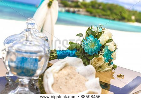beach wedding venue, wedding setup, cabana, arch, gazebo, wedding bouquet