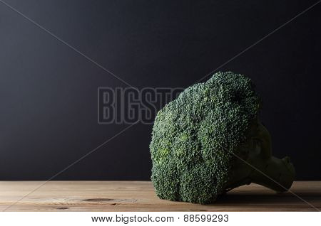 Head Of Broccoli On Wooden Table