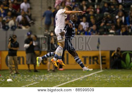 CARSON, CA. - APR 18: Robbie Rogers (L) & Jalil Anibaba in action during the L.A. Galaxy game against Sporting Kansas City on April 18, 2015 at the StubHub Center in Carson, California.