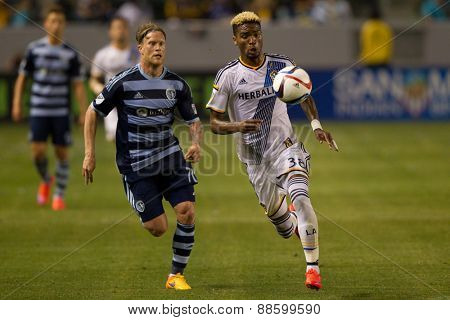 CARSON, CA. - APR 18: Bradford Jamieson & Marcel de Jong (L) in action during the L.A. Galaxy game against Sporting Kansas City on April 18, 2015 at the StubHub Center in Carson, California.