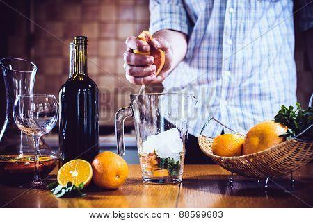 man squeezes grapefruit juice