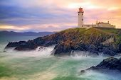 pic of cliffs  - Fanad Lighthouse sits on cliffs above stormy bay Co - JPG