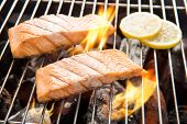 image of flame-grilled  - Grilled salmon with lemon on the flaming grill - JPG