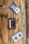 pic of heart sounds  - Vintage audio cassette with loose tape shaping one heart on a wooden background - JPG