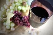 pic of grape  - top of glass of red grape juice with grape background - JPG