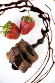 image of chocolate fudge  - chocolate brownie with fresh strawberry and chocolate sauce  - JPG