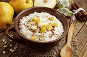 foto of ceramic bowl  - Oatmeal with caramelized apples in the ceramic bowl - JPG