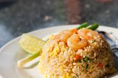 picture of shrimp  - fried rice with shrimp on top and lemon - JPG