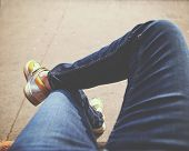 image of hot pants  - a hipster sitting downtown with crossed legs on a sidewalk bench on a sunny day toned with a retro vintage instagram filter app or action  - JPG