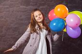 picture of ten years old  - Ten year old caucasian girl with long hair posing in the studio with ballons - JPG
