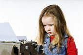 picture of typing  - Cute little girl typing letter on vintage typewriter keyboard - JPG