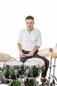 image of drum-kit  - Handsome guy behind the drum kit on a white background in shirt and trousers - JPG