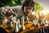 foto of chess piece  - Very serious man is playing the chess - JPG