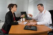 stock photo of prophylactic  - Pharmaceutical Sales Representative at hospital with a doctor - JPG