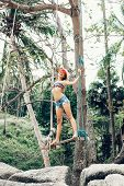 picture of swing  - Young happy woman having fun on a swing on a tropical beach - JPG