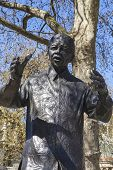 stock photo of nelson mandela  - A statue of former South African President Nelson Mandela situated on Parliament Square in London - JPG