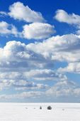 picture of snow clouds  - landscape marvelous white clouds in the blue sky above snow - JPG