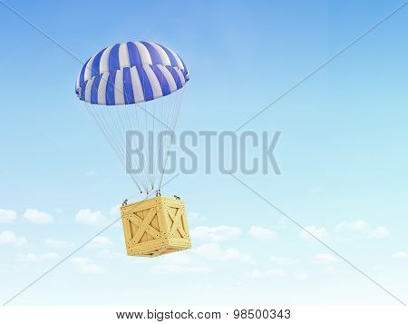 Concept Of Fast Delivery. Wooden Box Falling On The Parachute On A Sky Background.